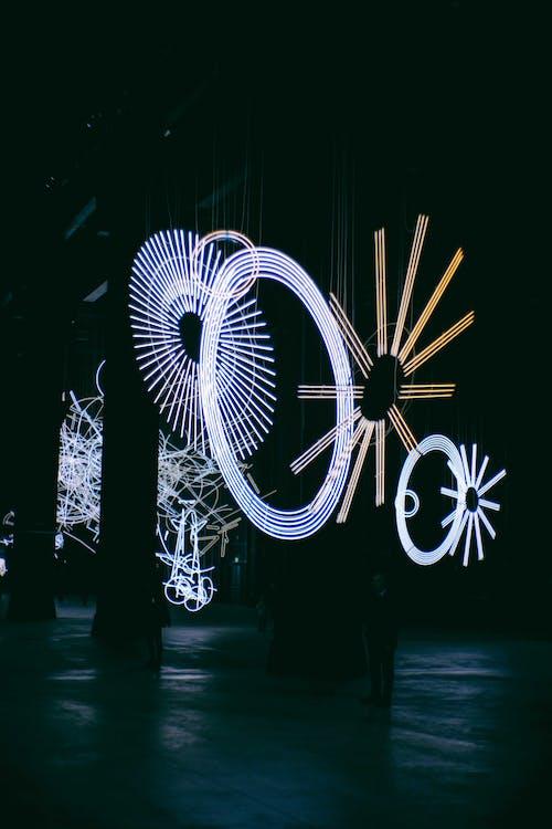 Glowing geometric figures at night