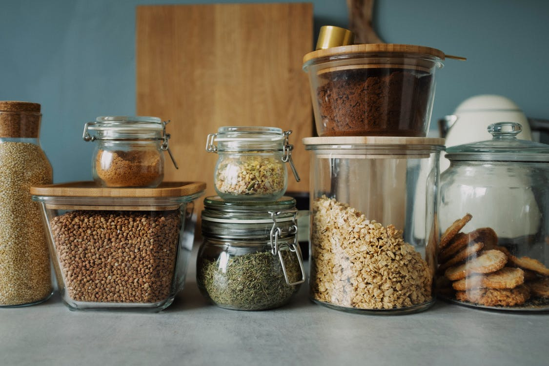 Clear Glass Jars With Brown Powder