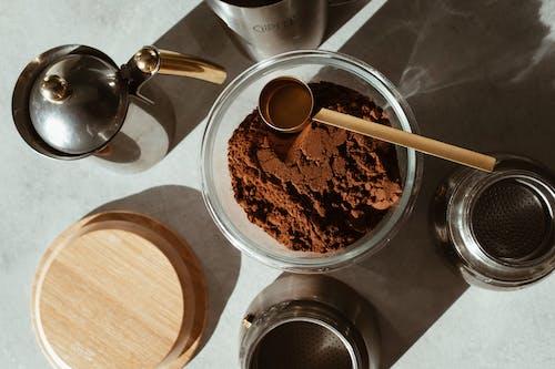 Stainless Steel Spoon on Brown Coffee Powder