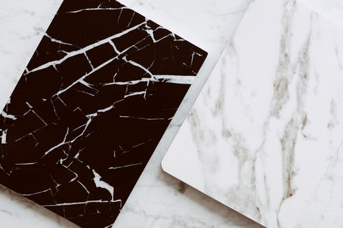Trendy marble styled planners on table