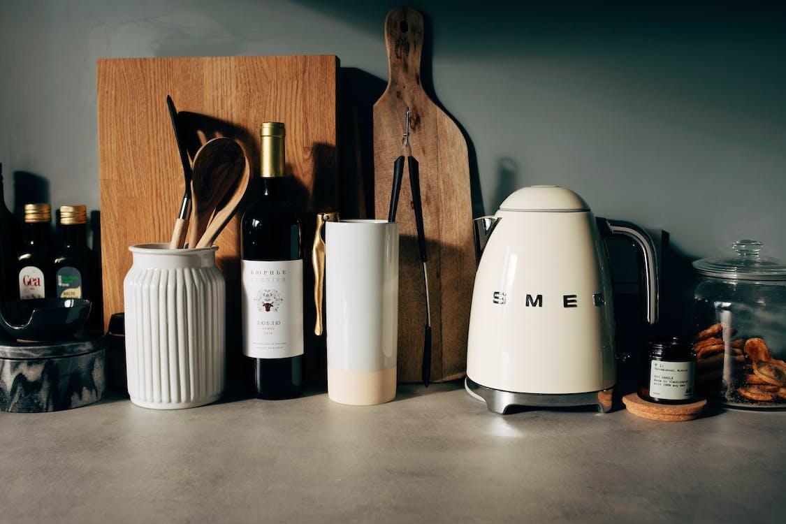Kitchenware on stone counter in modern kitchen