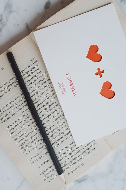 White Printer Paper With Red Heart Print
