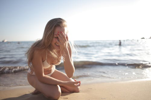 Happy woman having fun on beach