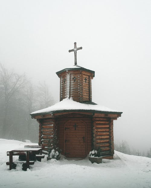 Brown Wooden Church Covered In Snow
