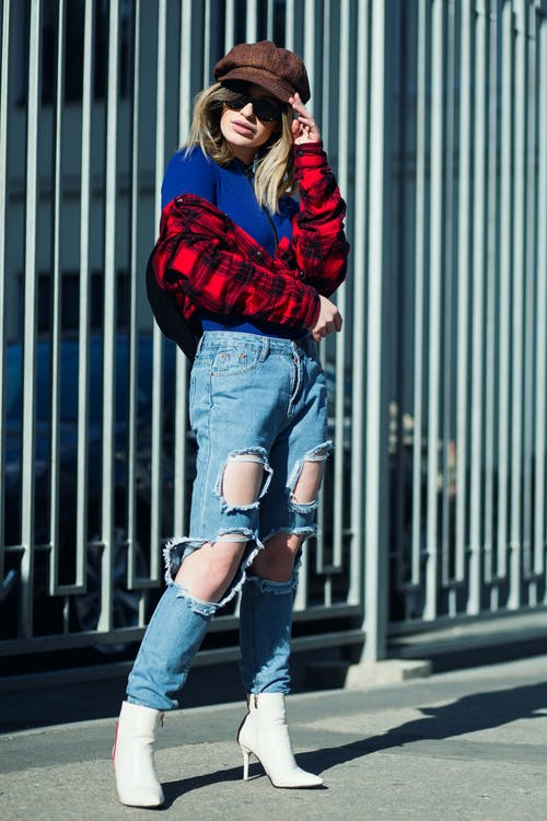 Woman In Red Jacket And Blue Denim Jeans