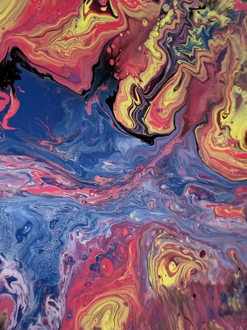 From above of oil picture with blended paints creating contrast between water fluids and multicolored swirls