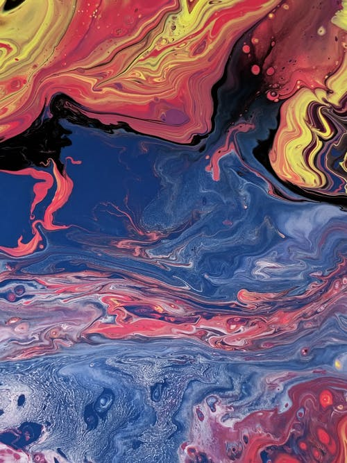 Top view of multicolored abstract background representing river flow and intense fire flame near fantasy swirls and small stains