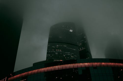 Spooky fog covering high rise skyscrapers