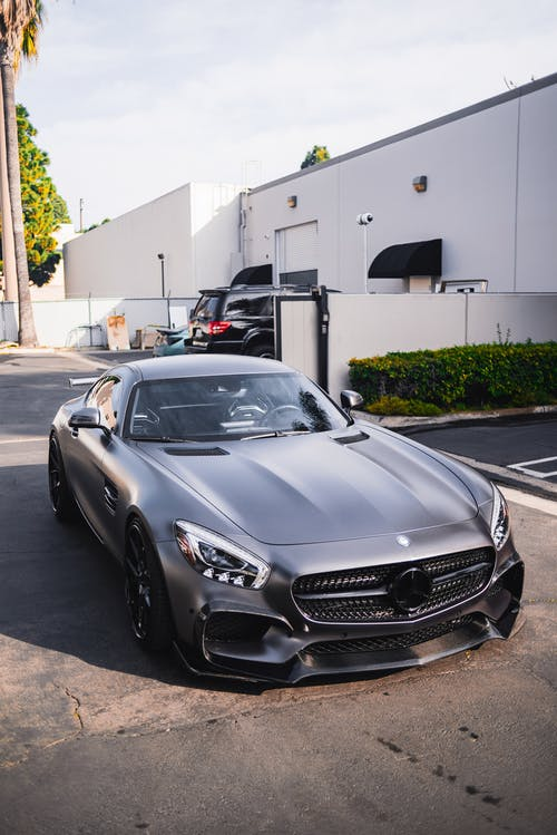 Black Mercedes Benz Parked on Parking Lot
