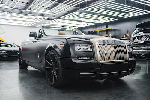 Modern black car parked in garage