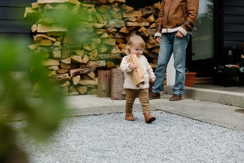 Little Girly Carrying Firewood