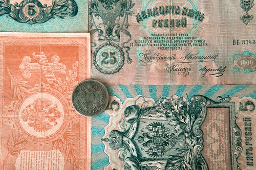 Set of old Russian banknotes and coin
