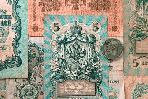 Weathered defunct Russian banknotes and coin
