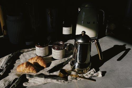 Black Coffee Maker Beside Bread