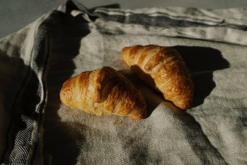 Croissant On White Textile