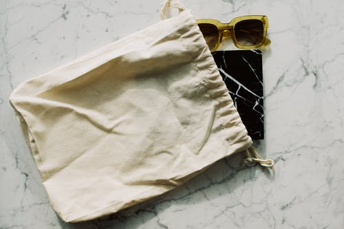 Notepad and sunglasses with cotton bag