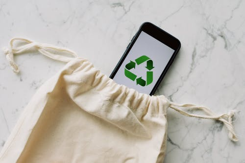 Eco friendly bag and phone with recycle logo