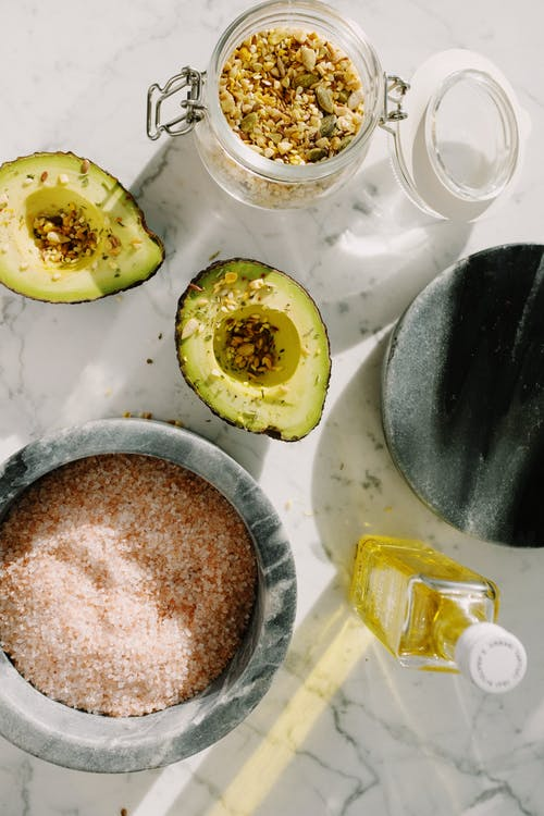 Fresh avocado slices with seed mix and other ingredients for healthy breakfast