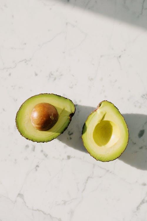 Sliced Avocado Fruit On White Surface