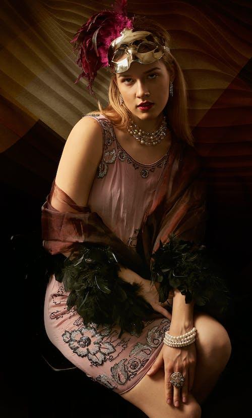 Woman in Brown Sleeveless Dress