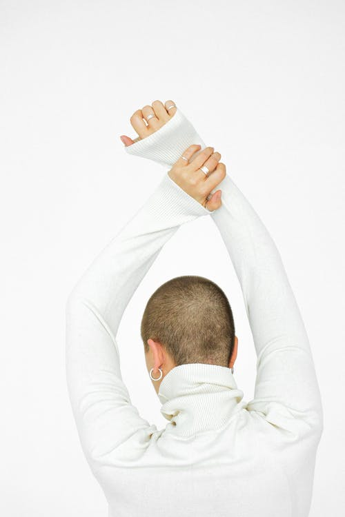 Person Wearing White Long Sleeves Shirt