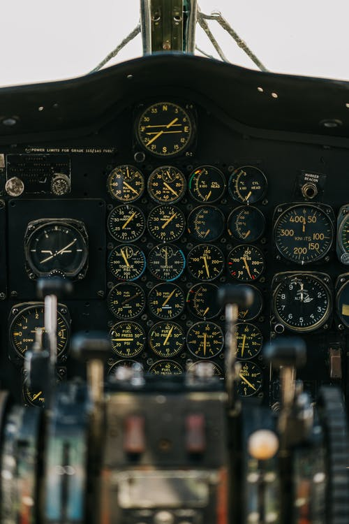 Modern military airplane flight deck with blurred dashboard against panel with gauges