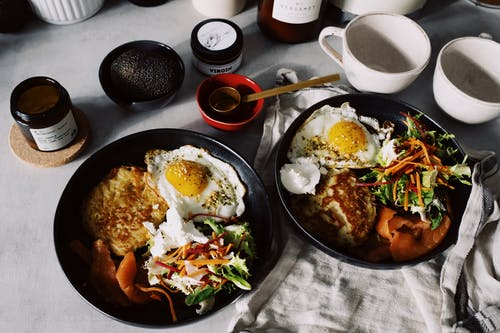 Cooked Food On Black Ceramic Plates