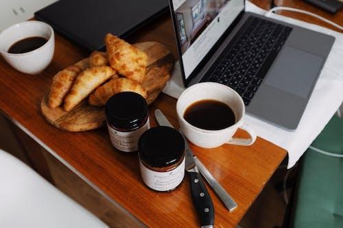 White Ceramic Mug Beside A Laptop
