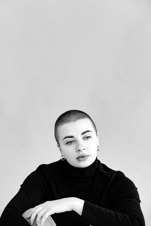 Grayscale Photo Of Woman In Black Turtleneck Shirt