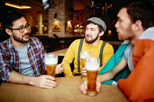 Men Talking at a Bar