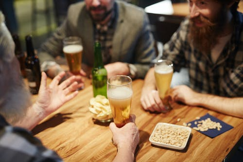 Men Talking at a Bar