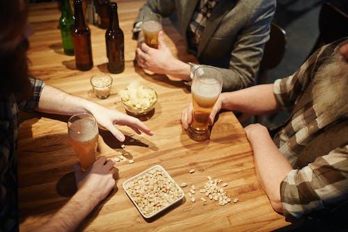 Men With Beer at a Bar