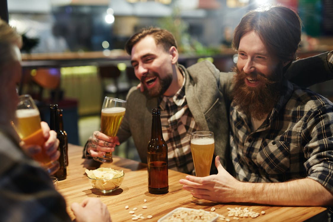 Men Laughing and Drinking Beer