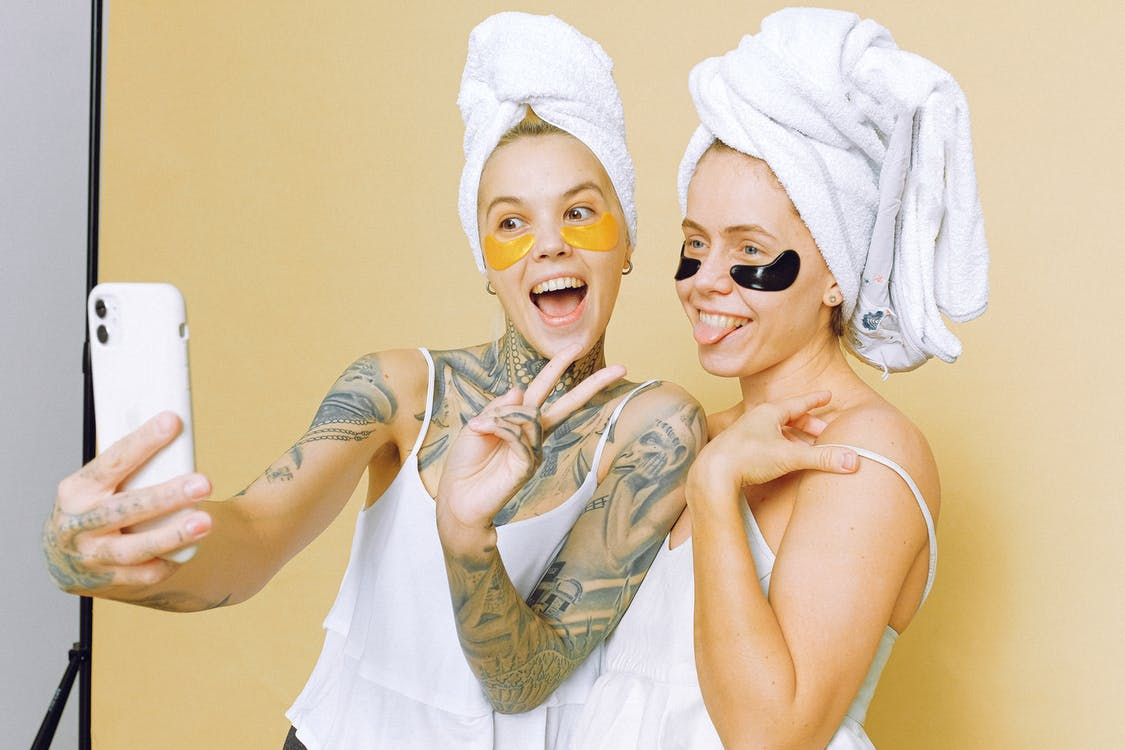 Women In White Tank Tops With Towels On Their Heads