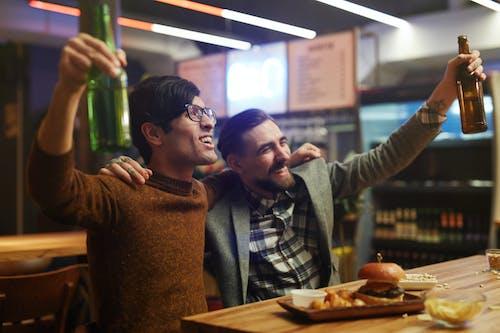 Men Celebrating at a Bar