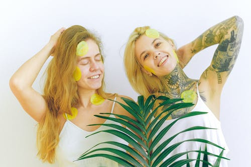 Cheerful women with green plant smiling and resting