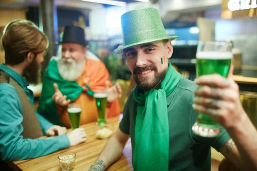 Man With Green Beer in Hand