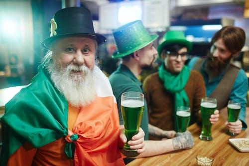 Senior Man Holding Green Beer