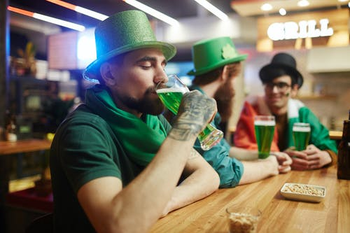 Man Drinking Green Beer