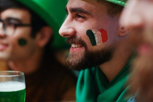 Man in Green Shirt Smiling