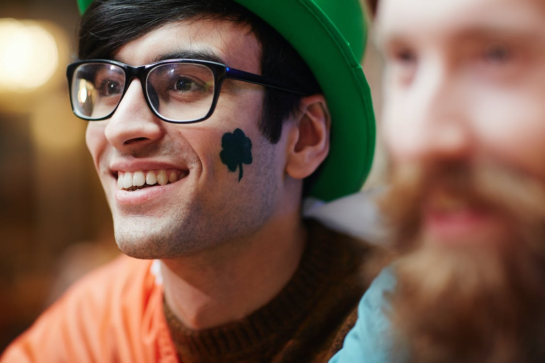 Smiling Man With Shamrock Painted on his Face