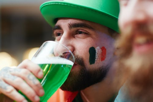 Man Drinking Green Beer