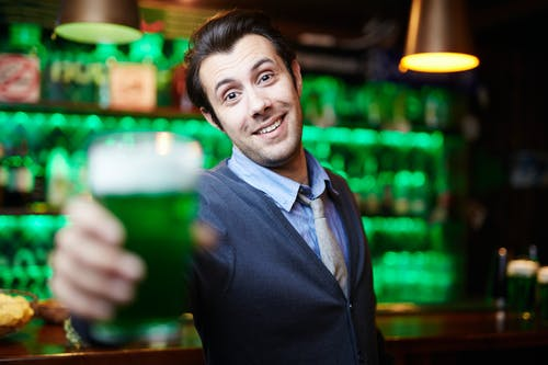 Man Smiling at a Bar