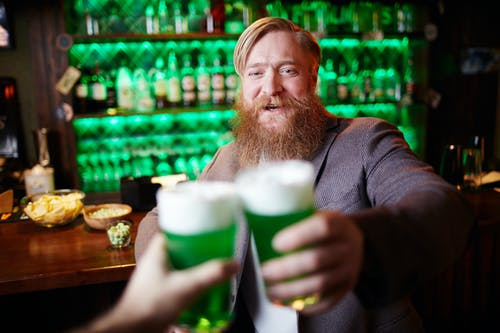 Man Toasting With Green Beer