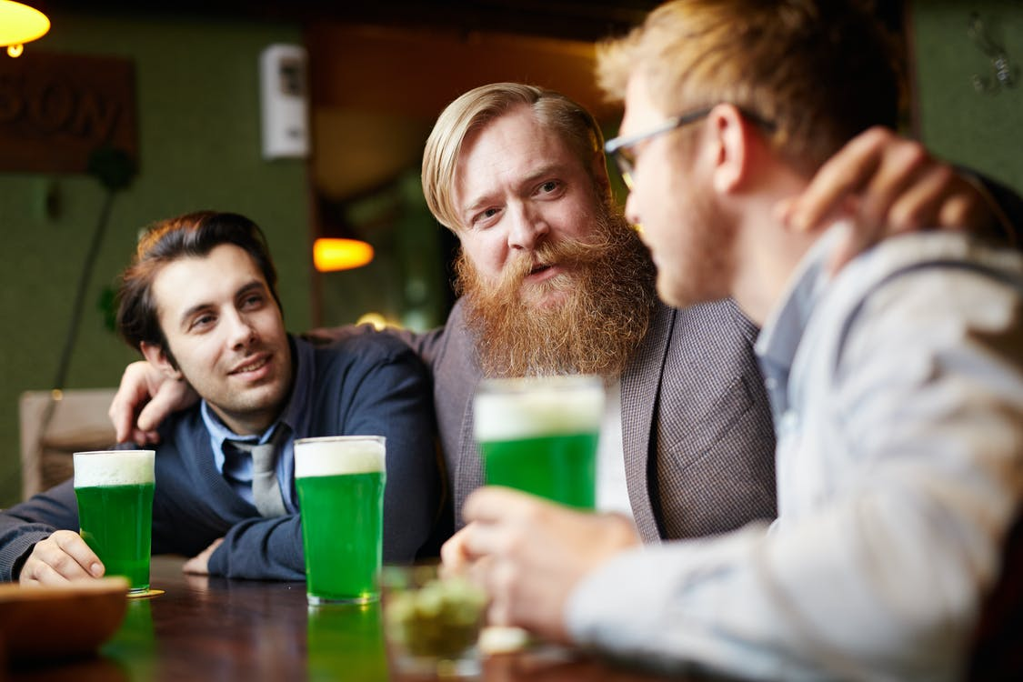 3 Men Having a Chat over a Drink