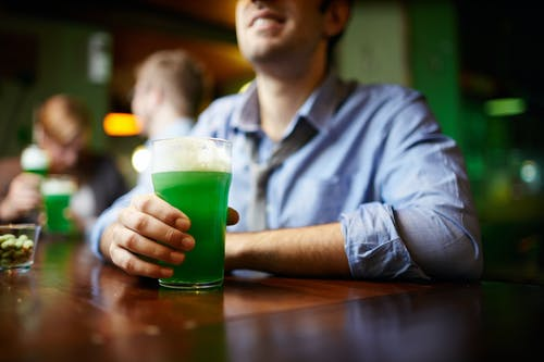 Man in Shirt Holding Green Beer