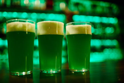 3 Clear Drinking Glasses With Green Beer