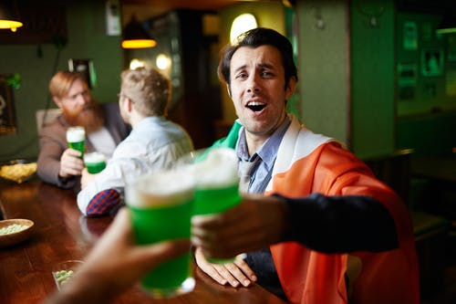 Men Toasting at a Bar
