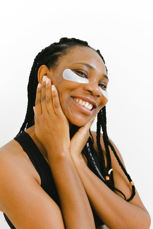 Cheerful black woman smiling in studio