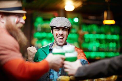 Happy Men Cheering at a Bar